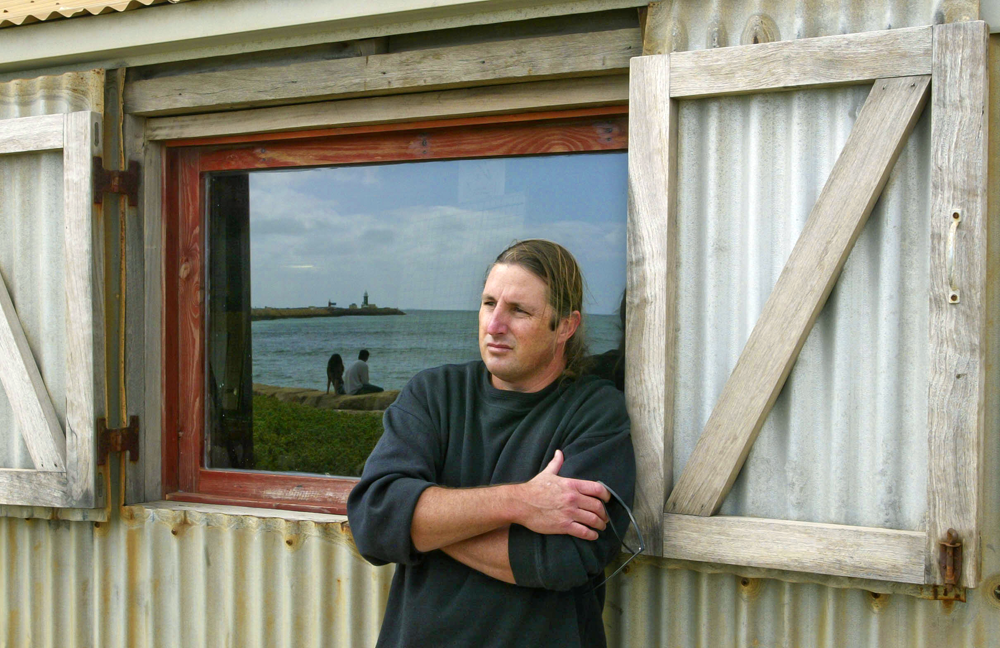 Author Tim Winton reflects at Bathers beach, Fremantle
